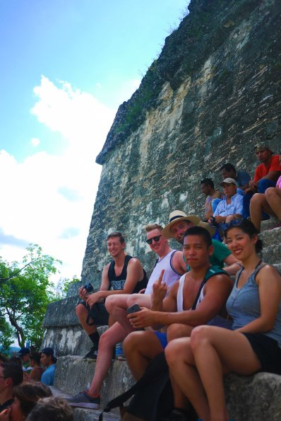 Taking in the views at the top of a temple in Tikal