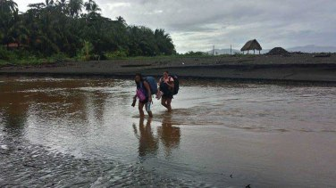 Wading through a river channel with all our belongings on our backs, Santa Catalina, Panama