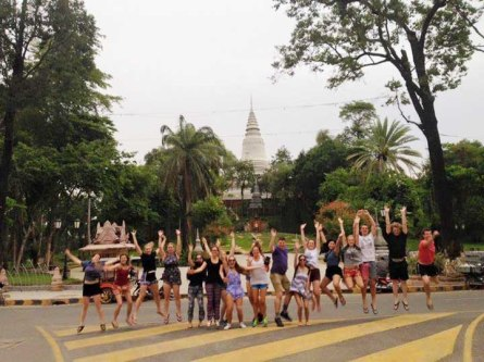 Taking jumping photos in the middle of a busy intersection, Cyclo Tour of Phnom Penh, Cambodia